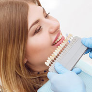 Caselle Dental, LLC | Woman Comparing Tooth Color